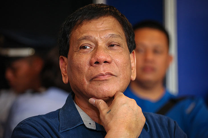 Duterte backs off claim he tossed man from helicopter - sort of